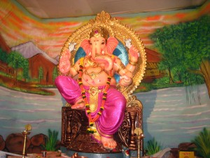 A bright Lord Ganesh with painted scenery background.