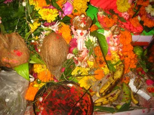 Small statues of Lord Ganesh draped in flowers.