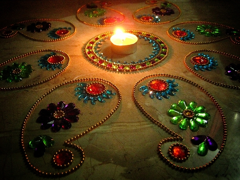Post image for groovy diwali rangoli floor art for Floor rangoli design
