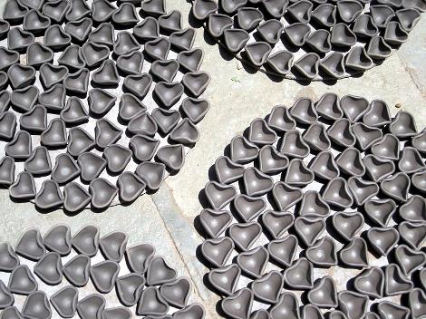 Small heart shaped diyas drying.